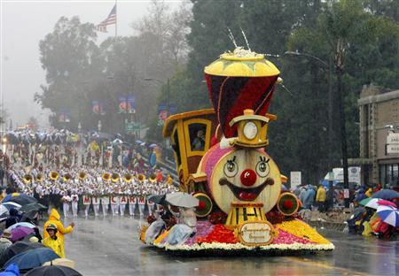 A float drives down Colorado Boulevard during the 117th annual tournament of Roses Parade in Pasadena, California, in this January 2, 2006 file photograph.   REUTERS/Lucas Jackson/Files