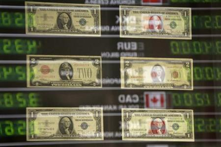 U S Banknotes Are Seen Through A Gl Window Reflecting Currency Exchange Rates Board At Office In Warsaw September 14 2017
