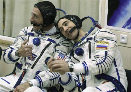International Space Station (ISS) crew members U.S. astronaut Daniel Burbank (L) and Russian cosmonaut Anatoly Ivanishin sit in their space suits at Baikonur cosmodrome November 14, 2011. REUTERS/Mikhail Metzel/Pool