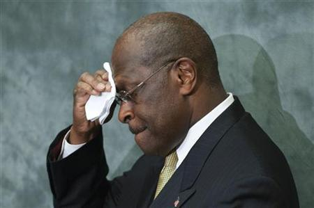 Republican presidential candidate Herman Cain wipes his brow during remarks to legislators in the Congressional Health Care Caucus on Capitol Hill in Washington November 2, 2011. REUTERS/Jonathan Ernst