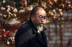 <p>Dissident Chinese artist Ai Weiwei walks to the door of his home after talking to his lawyers in Beijing November 14, 2011. REUTERS/David Gray</p>