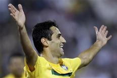 Brazil's Jonas Oliviera celebrates after scoring against Egypt during their friendly soccer match in Doha November 14, 2011.  REUTERS/Mohammed Dabbous