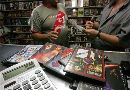Copies of fake DVDs are seen on sale at a Pirate City shop in Caracas May 26, 2006.  REUTERS/Francesco Spotorno