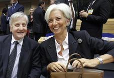 Глава МВФ Кристин Лагард и президент ЕЦБ Жан-Клод Трише на встрече министров финансов ЕС в Брюсселе 22 октября 2011 года. Еврозона и Международный валютный фонд (МВФ) рассматривают возможность кредитования МВФ Европейским центробанком (ЕЦБ), чтобы обеспечить достаточное финансирование для оказания финансовой помощи даже крупнейшим странам блока, сообщили в четверг чиновники еврозоны. REUTERS/Thierry Roge