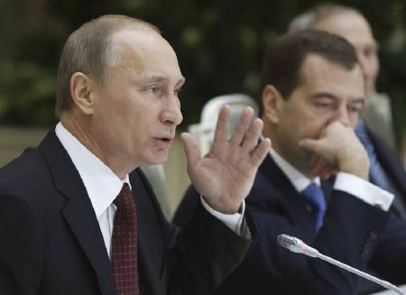 Russian Prime Minister Vladimir Putin (L) speaks as President Dmitry Medvedev looks on during a meeting with pensioners in Moscow's Kremlin November 17, 2011. REUTERS/Vladimir Rodionov/RIA Novosti/Kremlin