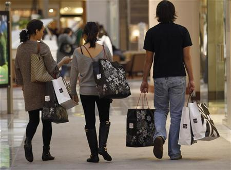 Shoppers Carry Their Purchases During Black Friday At A High End Shopping Mall In Tysons Corner Virginia November 26 2010 REUTERS Jason Reed