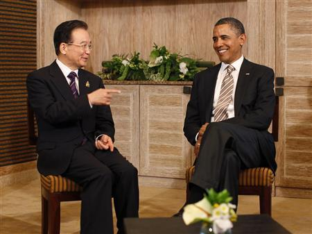 U.S. President Barack Obama (R) meets with China's Premier Wen Jiabao on the sidelines of the East Asia Summit in Nusa Dua, Bali, November 19, 2011.  REUTERS/Jason Reed