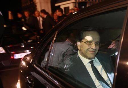 Antonis Samaras smiles as he leaves the presidential palace after a meeting with President Karolos Papoulias and Prime Minister George Papandreou in Athens November 6, 2011. REUTERS/John Kolesidis