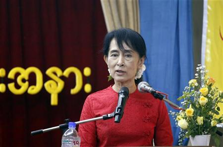 Myanmar's pro-democracy leader Aung San Suu Kyi speaks at a ceremony to mark the country's National Day at the National League for Democracy (NLD) party's head office in Yangon November 20, 2011. REUTERS/Soe Zeya Tun