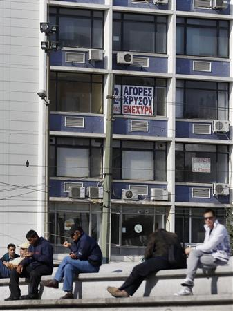 A sign that reads ''Loans, Pawn, Gold'' is seen on a building in Omonia Square in Athens, November 2, 2011.  REUTERS/Yiorgos Karahalis