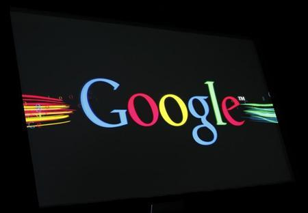 The Google Inc logo is projected on a screen during the unveiling of ''Google Instant'' at a news conference in San Francisco, California September 8, 2010. REUTERS/Robert Galbraith