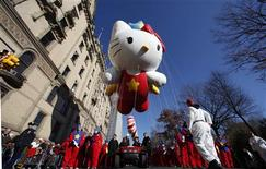 <p>The Super Cute Hello Kitty balloon floats down Central Park West during the 85th Macy's Thanksgiving day parade in New York November 24, 2011. REUTERS/Gary Hershorn</p>