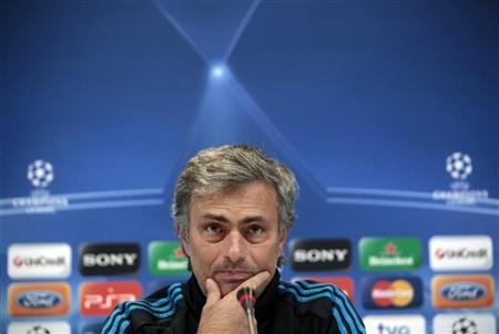 Real Madrid's coach Jose Mourinho gestures during a news conference after his team's training session at Valdebebas training ground in Madrid November 21, 2011, ahead of their Champions League match against Dinamo Zagreb. REUTERS/Susana Vera