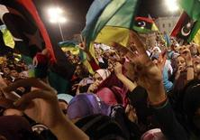 <p>Members of the Libyan Amazigh or Berber ethnic group celebrate at a rally at Martyrs' Square in Tripoli September 27, 2011. REUTERS/Suhaib Salem</p>