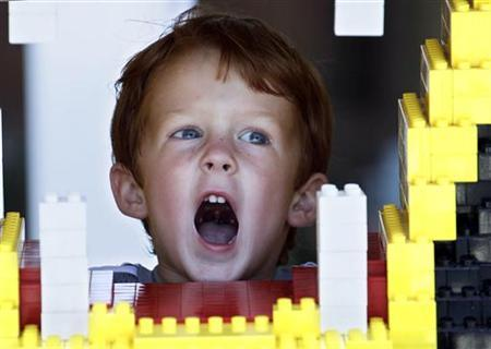 Greyson Middleton, 3, growls like a lion in the playground as he attends Legoland Florida's grand opening celebration in Winter Haven, Florida October 14, 2011. largest Legoland in the world -- prepares to open to the public this weekend southwest of Orlando. REUTERS/Pierre DuCharme
