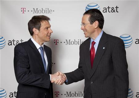 AT&T Chairman and CEO Randall Stephenson (R) and Deutsche Telekom Chairman and CEO Rene Obermann (L) shake hands after announcing AT&T's $39 billion acquisition of T-Mobile USA from its German parent, New York, March 16, 2011.  REUTERS/Mark Dye-Newscast/Handout