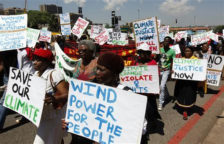 Locals take part in a march, against climate change ahead of South Africa hosting global climate talks starting next week, in Durban, November 26, 2011. REUTERS/Siphiwe Sibeko
