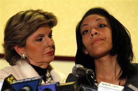 Cristina Fierro (R), 18, stands with attorney Gloria Allred during a news conference in New York, November 28, 2011. Fierro sued former NFL star Lawrence Taylor on Monday for unspecified damages following Taylor's January 2011 case where he admitted that he had paid for sex with Fierro when she was 16-years-old for which he received six years probation.  REUTERS/Mike Segar