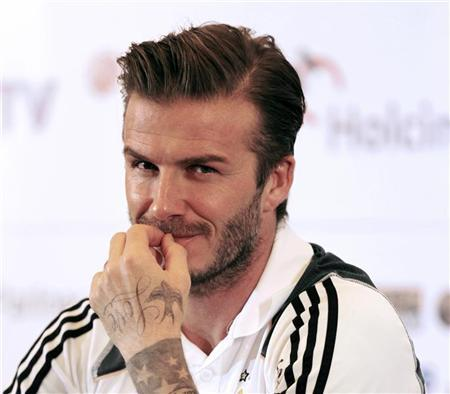 Los Angeles Galaxy's David Beckham reacts during a news confrence in Jakarta November 28, 2011. REUTERS/Beawiharta