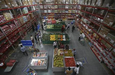Customers shop at a wholesale store in Jammu November 26, 2011. REUTERS/Mukesh Gupta/Files