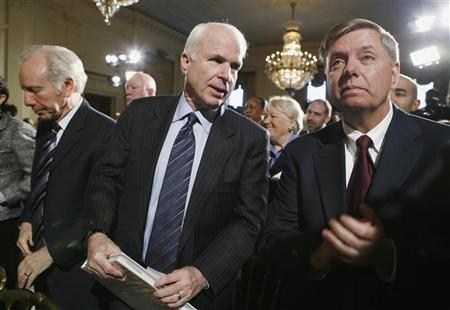 Senators Joe Lieberman (L), John McCain (C) and Lindsey Graham listen to remarks at the Fiscal Responsibility Summit hosted by President Obama at the White House in Washington February 23, 2009.  REUTERS/Kevin Lamarque