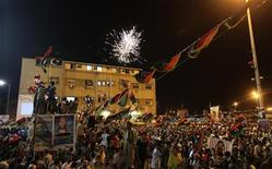 <p>Fireworks explode as people gather near the courthouse in Benghazi August 22, 2011 to celebrate the entry of rebel fighters into Tripoli. REUTERS/Esam Al-Fetori</p>