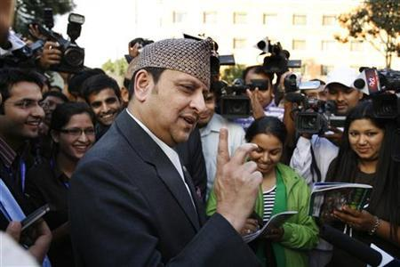 Former King Gyanendra Shah speaks to the media after inaugurating former Crown Princess Himani Shah's non-governmental organization ''Himani Fund'' in Kathmandu October 8, 2010. REUTES/Navesh Chitrakar/Files