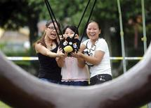 <p>Visitors use a slingshot to shoot an Angry Bird plush toy at a real life Angry Birds outdoor game in a theme park at Changsha, Hunan province September 1, 2011. REUTERS/China Daily</p>