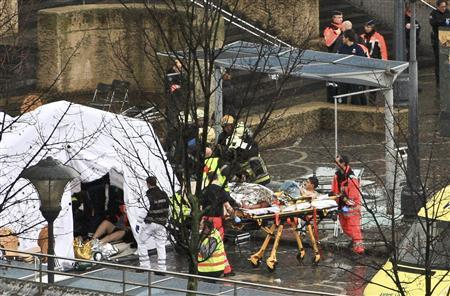Rescuers evacuate injured people at the Place Saint Lambert square where two men threw explosives in the city center of the Belgian city of Liege December 13, 2011.  REUTERS-Thierry Dricot