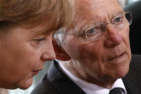 German Chancellor Angela Merkel (L) talks to Finance Minister Wolfgang Schaeuble during a cabinet meeting in Berlin, June 6, 2011. REUTERS/Fabrizio Bensch