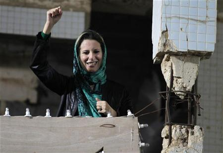 EDITOR'S NOTE: PICTURE TAKEN ON GUIDED GOVERNMENT TOUR  Aisha Gaddafi, daughter of Libya's leader Muammar Gaddafi, greets her father's supporters at the heavily fortified Bab al-Aziziya compound in Tripoli April 14, 2011.  REUTERS/Zohra Bensemra