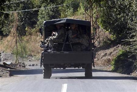 A Turkish military convoy drives down a mountain road in Yemisli, Hakkari province near the Iraqi border in southeastern Turkey October 21 2011. REUTERS/Osman Orsal/Files