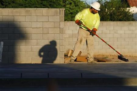 A worker sweeps the foundation of a house being constructed in Phoenix, Arizona, August 23, 2011.  REUTERS/Joshua Lott