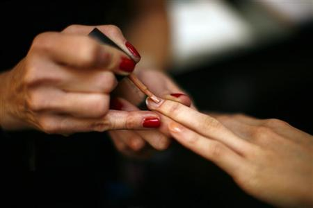 A model has her nails painted backstage before the Jenni Kayne Fall/Winter 2011 collection show during New York Fashion Week February 10, 2011. REUTERS/Eric Thayer