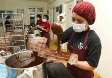 <p>A worker pours chocolate into a mould at Monggo Chocolate factory in Yogyakarta December 19, 2011. The growing taste for high quality chocolate in emerging markets -- especially in Asia -- will help boost global chocolate sales 2 percent to $81.8 billion in 2011, according to Mintel. Chocolate sale in China are forecast to rise 19 percent to $1.2 billion this year, and in India by 7 percent to $633 million, with Indonesian sales likely to jump 25 percent to $1.1 billion, data from the market research firm showed. To match Feature INDONESIA-COCOA/ REUTERS/Dwi Oblo</p>