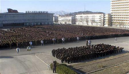 North Koreans make a call of condolence for their deceased leader Kim Jong-il at the Haean Plaza in Wonsan December 23, 2011. REUTERS/KCNA