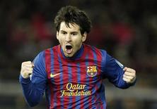 Lionel Messi, do Barcelona, comemora gol contra o Santos na final do Mundial de Futebol em Yokohama, Japão. 18/12/2011  REUTERS/Toru Hanai