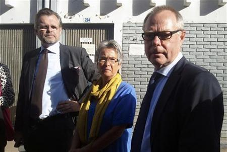 Kjell Persson (R) and Christina Persson (C), parents of Swedish photographer Johan Persson and Swedish ambassador to Ethiopia Jens Odlander (R), stand outside the courtroom in Ethiopia's capital Addis Ababa, December 21, 2011. REUTERS/Kumera Gemechu