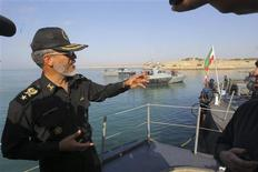 Iran's army's navy commander Habibollah Sayyari (L) gestures as he speaks with media during the Velayat-90 war game on Sea of Oman near the Strait of Hormuz in southern Iran December 28, 2011.  REUTERS/Fars News/Hamed Jafarnejad