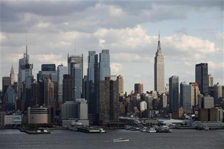 The Empire State Building (R) stands tall on the skyline of midtown Manhattan in New York, October 15, 2011. REUTERS/Gary Hershorn