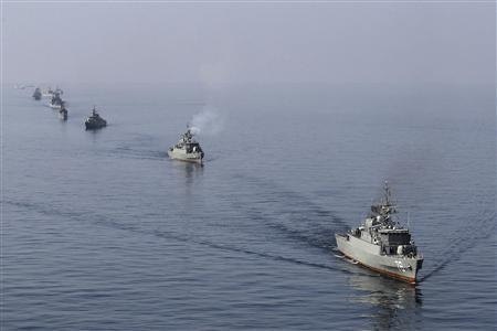Iranian naval ships take part in a naval parade on the last day of the Velayat-90 war game in the Sea of Oman near the Strait of Hormuz in southern Iran, January 3, 2012. REUTERS/Jamejamonline/Ebrahim Norouzi