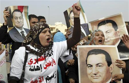 Supporters of Egypt's former President Hosni Mubarak shout slogans outside the police academy, where his trial will take place, in Cairo January 2, 2012. REUTERS/Mohamed Abd El-Ghany