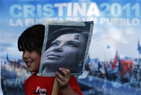 A girl holds a picture of Argentina's President Cristina Fernandez de Kirchner outside Hospital Austral in Pilar, on the outskirts of Buenos Aires, January 3, 2012. REUTERS/Marcos Brindicci