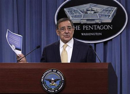 U.S. Secretary of Defense Leon Panetta holds up a copy of the Defense Strategic Review after it was introduced by U.S. President Barack Obama (not pictured) at the Pentagon near Washington, January 5, 2012. REUTERS/Jason Reed
