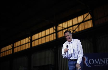Republican presidential candidate and former Massachusetts Governor Mitt Romney speaks during a town hall meeting at the Missouri Valley Steel in Sioux City, Iowa in this December 16, 2011 file photograph.  REUTERS/Jim Young/Files