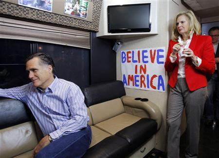 Mitt Romney is interviewed on his campaign bus, as his wife Ann (R) listens on, in Bethlehem, New Hampshire December 22, 2011. REUTERS/Brian Snyder/Files