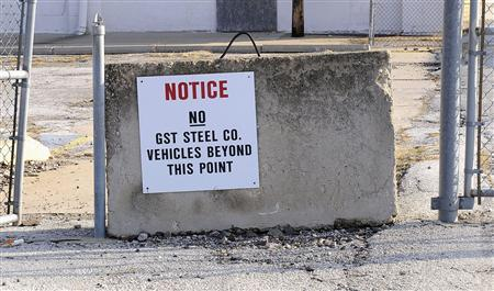 An old sign gives notice that GST Steel Company vehicles were not welcome at a surviving industrial plant in Kansas City, Missouri December 15, 2011. REUTERS/Dave Kaup
