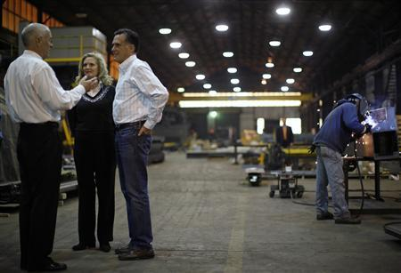 Mitt Romney (3rd L) and his wife Ann tour the Missouri Valley Steel in Sioux City, Iowa, December 16, 2011 file photograph. REUTERS/Jim Young