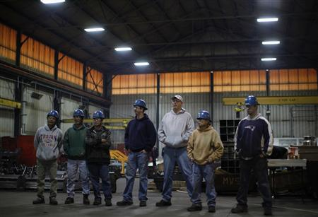 Workers at the Missouri Valley Steel wait for Mitt Romney to speak at a town hall meeting in Sioux City, Iowa, December 16, 2011. REUTERS/Jim Young/Files
