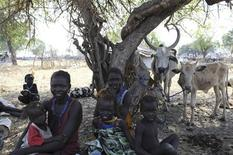 Internaly displaced people sit under a tree in Pibor January 5, 2012.  REUTERS/Isaac Billy/United Nations Mission in South Sudan/Handout